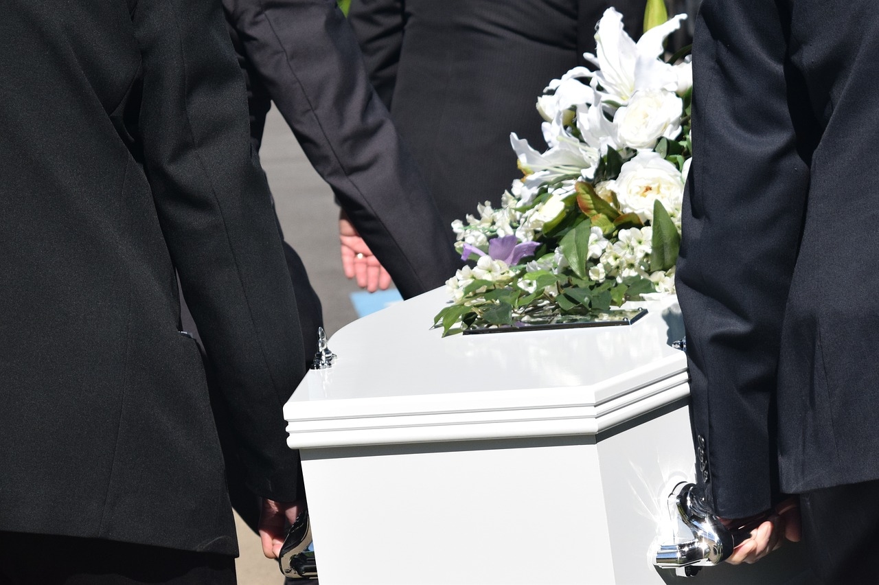 Image of pallbearers carrying a coffin