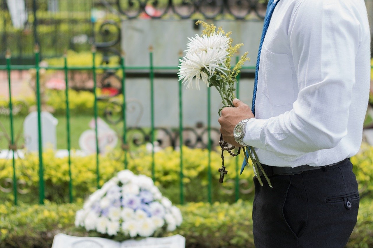 Image of someone at a funeral